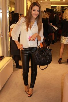 A super simple and elegant look is a crisp white shirt with your leather pants, and a pair of heels.
