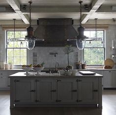 perfect kitchen! add a mini fridge to the island, see through cabinets and instead of lights- hang pots and pans