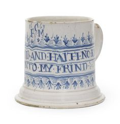 An important London delftware tankard, dated 1663 -   Of generous proportions tapering slightly to neatly-turned bands around the spreading foot, the plain strap handle with a rolled lower terminal, Painted in blue with an unrolled banner cartouche edged with graduated loops and barbs and inscribed