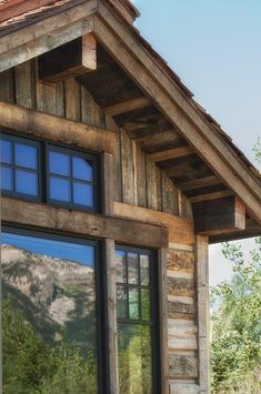 Teton National Park is almost in the backyard and this house which uses hand-hewn skins, barnwood siding, and barnwood fascia.