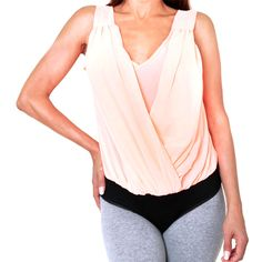 Vibrant stretchy bodysuit blouse with Loose V Style Neckline. Comfortable 95 % rayon and 5 % spandex, sleeveless cut, flexible and elegant for any occasion. $29.25