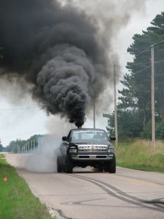 """""""Rollin' Coal"""" Is Pollution Porn For Dudes With Pickup Trucks Jacked Up Trucks, Dodge Trucks, Cool Trucks, Big Trucks, Pickup Trucks, Redneck Trucks, Redneck Boys, Truck Flatbeds, Lowered Trucks"""
