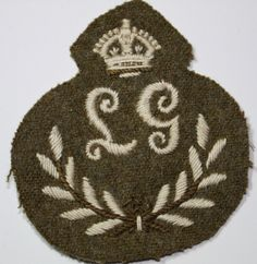 This is an original and extremely rare British cloth arm badge of being the Prize arm badge for a Lewis Gunner, consisting of the letters 'LG' in a wreath surmounted by a King's Crown. Kings Crown, British Army, Badges, Arms, Letters, The Originals, Ebay, Badge, Letter
