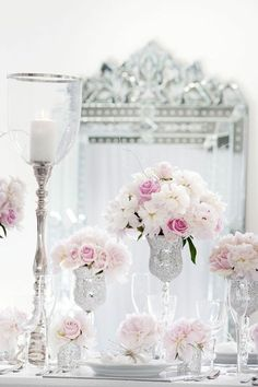 Elegant centerpieces ! I love crystal, candles and flowers !!