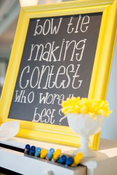 #games, #chalkboard, #baby-shower, #yellow, #frame  Photography: Maya Myers Photography - mayamyers.com  Read More: http://www.stylemepretty.com/living/2014/01/06/smp-living-graphic-print-inspired-baby-shower/
