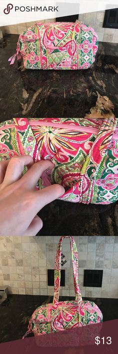30% Off Bundles! Vera Bradley Bag Pinwheel Pink patterned Bag. 3 pockets on one side of the inside. 2 pockets on the other (1 zippered). Keychain on the inside as well. One pocket on the front. Small stain on the front. Vera Bradley Bags Shoulder Bags