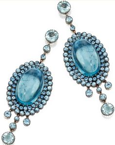 PAIR OF 18 KARAT WHITE GOLD AND AQUAMARINE PENDANT-EARRINGS The pendants set with oval cabochon aquamarines weighing 49.93 carats, set throughout with round aquamarines weighing 15.46 carats.