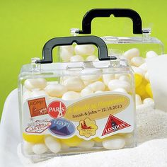Mini Travel Suitcase Favors by Beau-coup    Use these as the containers for the candy bar.