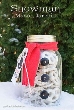Snowman Mason Jar Filled with white chocolate dipped pretzels