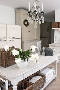 i don't know what i love most about this kitchen! farmhouse table, chandelier, old cupboard...love!
