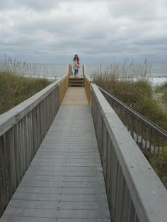 My daughter heading to the beach for a November stroll to the inlet.