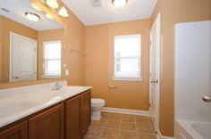 Second floor shared bathroom, with dual vanities and combination tub & shower.  Door leads to linen closet.