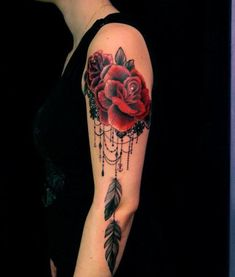 Lace and roses become a feminine dreamcatcher tattoo design in this tattoo for women by Dodie