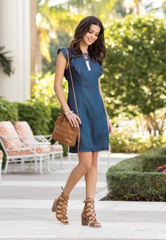 Best Of Both Worlds | Add a touch of femininity to your everyday look in this chambray shift dress, featuring a double ruffle design. A stitched stripe crossbody, statement fringe stone collar choker and ghille lace up heeled sandals for added glamour.