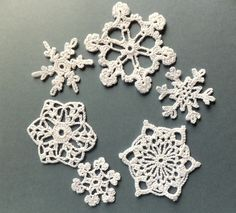Handmade Christmas tree ornaments, decorations crocheted snowflakes, white applique /set of 6/. $16.00, via Etsy.