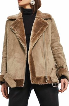 Topshop Faux Shearling Biker Jacket. Buckled straps and bright hardware toughen up a retro-inspired faux-shearling jacket that's rugged on the outside and warm and fuzzy on the inside. Spotted on Nordstrom.com