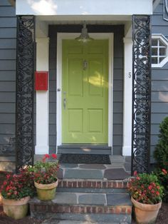 exterior color scheme - blue/gray siding, green door, red porch chairs. too much?