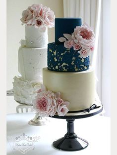 How pretty is this vintage looking 3 tier wedding cake with navy blue lace overlay on top of gold?