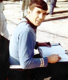 slashks:   Leonard Nimoy on set of Star Trek: TOS 1968  What your reading there Spocky?