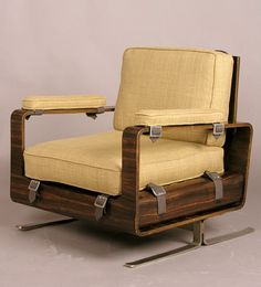 Anonymous; Ebony-Veneered Plywood, Steel and Leather Lounge Chair by Raphael, c1970.