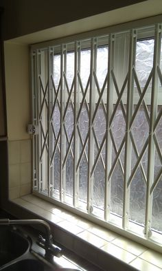 RSG1000 retractable security grille fitted to the kitchen window of a residential property in Fulham.