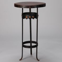 Arts and Crafts Bronze Metal Gueridon Table  --  Circa 1930s small bronze gueridon side table is supported on three feet, has polished brass embellishments on the top spreader and round forms in relief around the apron. Visible patina to table top and base.  --   Item:  6503  --  Price:   $1895