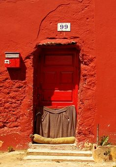 Red door with little coat.  Portugal.   from   bricolage 108