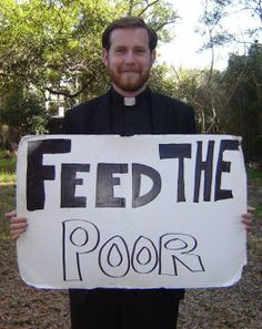 "Over the years many people through out Pensacola have seen Father Nathan standing at intersections, civic events and Gallery Night with his ""Feed the Poor"" sign."