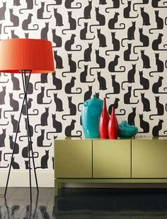 Adapted from an original 1930s archive print, this elegant cat design provides a perfect monochrome backdrop for coloured furniture and accessories.  From the Bloomsbury collection at Sanderson.
