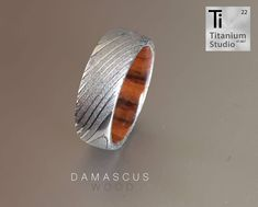 Damascus steel ring with wood inner. Damascus Ring, Damascus Steel, Titanium Rings, Wood Rings, Wedding Bands, Rings For Men, Wooden Rings, Men Rings, Titanium Ring