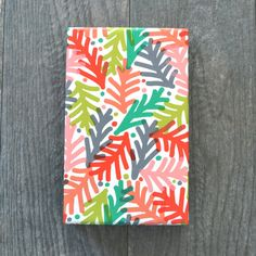 Brightly colored, simple pine branches in red, green, orange, coral, peach, gray, and chartreuse.  • 54 lb white semi-gloss paper • 100%