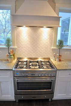 House Affairs: The Kitchen - Before and After Love the backsplash