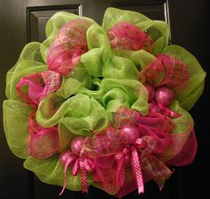 Hot Pink Ribbons and Ornaments with Lime Green Deco Mesh make up this Fun, Funkie Christmas Wreath