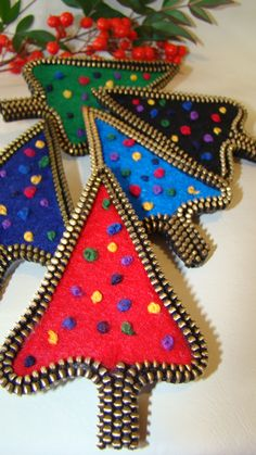 Felt and Zipper Christmas Tree Brooches. Brass colored zippers with bright felt trees and embroidered decorations.