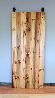 Sliding Barn Door made out of our authentic reclaimed barn wood. Fully Smooth texture with an amber finish.