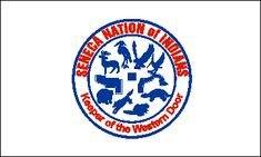 The three state-recognized Seneca reservations in western New York - the Cattaraugus, the Oil Springs, and the Allegany - all fly the same flag. It is white with the seal of the Tribe in blue, white, and red