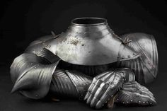 A selection of rare gothic armour pieces comprising of a collar, a pair of full arm defences and a pair of gauntlets, German circa 1480.