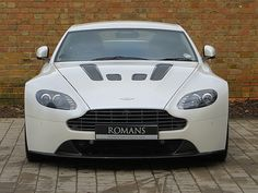 Romans are pleased to offer this Aston Martin Vantage for sale presented in Morning Frost White with Black Leather & Alcantara. Used Aston Martin, Aston Martin Cars, Aston Martin V12 Vantage, Sport Seats, Manual Transmission, Car Detailing, Used Cars, Luxury Cars, Autos