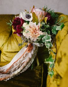 Love the colors in this, and the mix of different textures in the ribbons.  kinfolk inspired bouquet