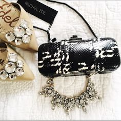 """🎉 HOST PICK 🎉 Rachel Zoe > Margaux Minaudière NWT black and white watersnake minaudière. Comes with dust bag. Frame and hinge snap. Coiled chain strap can be tucked into the interior when not in use. Strap drop 18"""". Bag measures approximately  7.5"""" L, 4 1/4"""" high. Rachel Zoe Bags Clutches & Wristlets"""