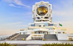 Proudly standing in the white marble city of Ashgabat, Wedding Palace is an aesthetic disaster like a mix between the homes of Aladdin and Thor. Its futuristic exterior boasts geometric squares, triangles, & octagons encasing a giant gold globe, mounted atop a stacked star-shaped government building. It's surreal.