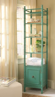 The St Barts Etagere is the perfect corner piece for your collectables. This piece is tall and narrow with 4 fixed shelves and a bottom cabinet. Pictured in a Gelato finish.