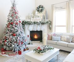Winter Wonderland Christmas living room by Nissa-Lynn Interiors. Complete with red and silver flocked Christmas tree.