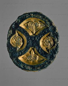 Bronze brooch with gold Lombard era, 7th century CE.  Museo Civico, Udine, Italy