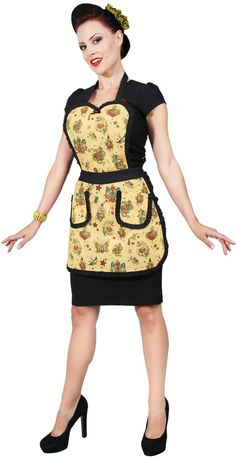 STEADY TATTOO APRON Whip up some treats in a flash! This vintage inspired apron from Steady features an all over traditional tattoo flash pattern, sweetheart neckline, ruffle trim, pockets and tied neck & waistband for perfect fit.