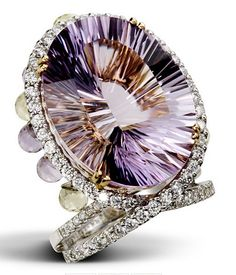 ♔ KISS OF DAWN  Like a jeweled crown, this ring features an amazing amethyst centerpiece accented with diamonds and adorned with smaller teardrop amethyst ornaments that hang along the profile of the ring for a stunning masterpiece.