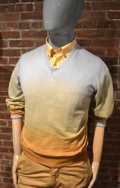 Best known for his colour, Scott James designs this ombre sweater as spotted at the ENK trade show today. WGSN product shot, New York.