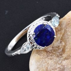 Charm the gathering with this Lapis Lazuli ring. Accented with sky blue topaz, the piece is set in sterling silver. Pair it with your favorite outfit and grace any occasion in style.  Free Shipping Gift Box