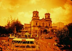 Taken during the Pamangan Fiestang Kapampangan in Angeles City, Pampanga using a Lomo LC-A+ camera loaded with Lomo Redscale XR 50-200 film #analog #analogue #orange #yellow #weekend  #sunny #summer #october #church #architecture #sky #streets