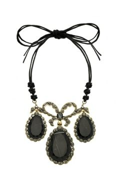As seen in the Spring/Summer 2014 Catwalk Show, Vivienne Westwood launches this exclusive jewellery collection. Taking inspiration from the rich culture of India, and in particular the Maharajas draped in their ornate jewels. The Baia Necklace beautifully presents three sumptuous medallions in black marble, topped with a Georgian inspired bow which is hung from traditionally knotted cord. This piece comes elegantly presented in a couture silk gift pouch.